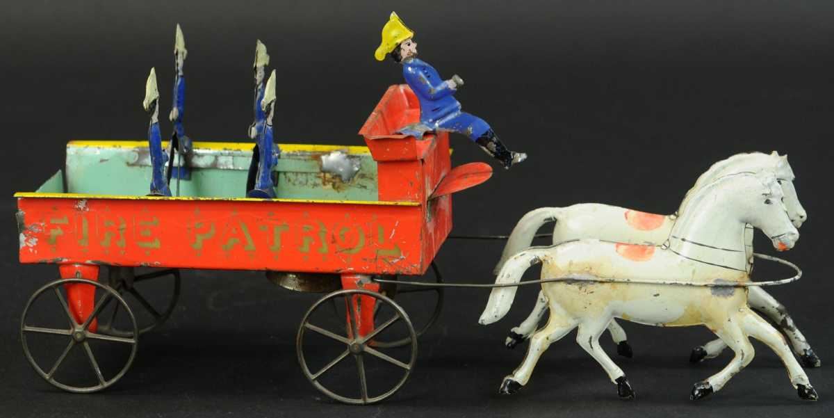 """The only known complete example of the Althof Bergmann Fire Patrol Wagon, this early hand-painted fire toy sold for $26,000 against a high estimate of $7,000; 16"""" l."""
