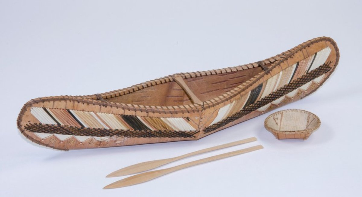 Birch-bark model canoe, 1869, sewn with spruce root and the exterior decorated with porcupine quills; contains a miniature birch-bark circular bowl and two wooden paddles. This was presented to Prince Arthur Duke of Connaught in Canada in 1869.
