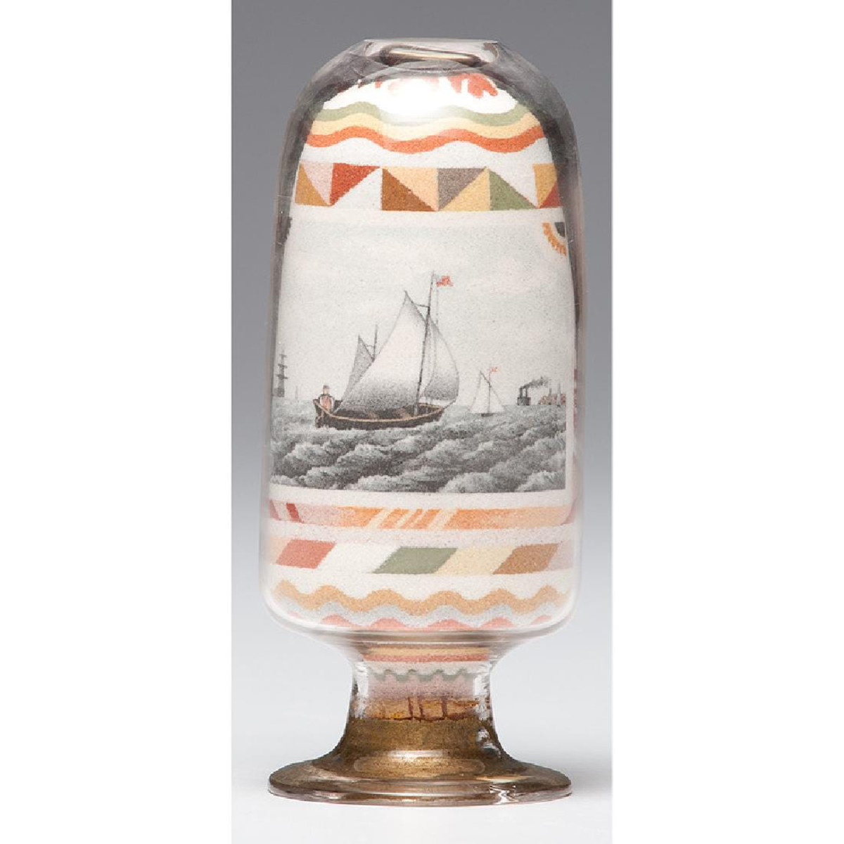 """This inverted sand bottle with a nautical and patriotic theme, 6-1/4"""" h, realized $108,000 at Cowan's in 2018."""