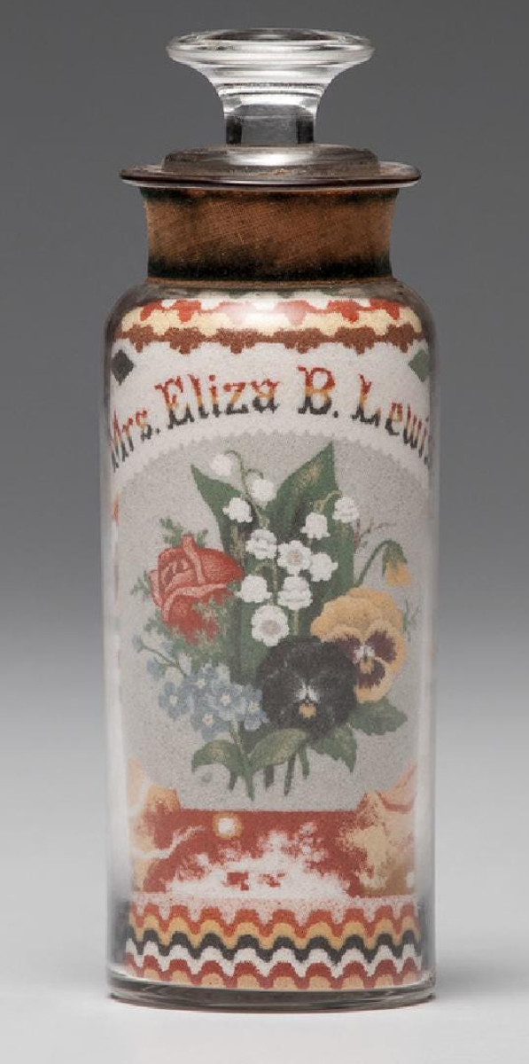 """A Clemens' sand bottle with an American spread-winged eagle underneath a flag of thirty-six stars on one side, the other having a floral bouquet below the name Mrs. Eliza B. Lewis, decorated with layered, colored sands in geometric patterns, 6-3/4"""" h; $132,000."""