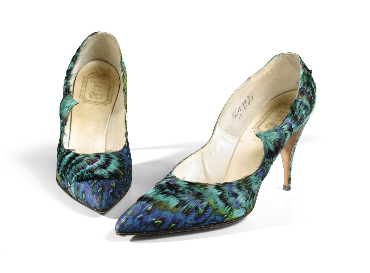 Feathers resonate with the magic of transformation and Roger Vivier became a master in the craft. These kingfisher-feathered and trompe-l'oeil-printed 1957 stilettos in brilliant hues feature a stylized swoop that dramatizes the line of the shoe. These sold at Sotheby's in 2017 for $6,184.
