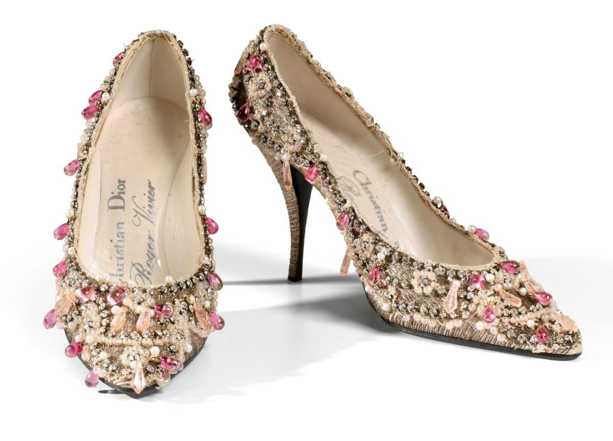 The ideal Cinderella shoe, this pair of haute couture evening heels by Roger Vivier for Dior, 1957-59, is fashioned in delicate pink tulle and hand embroidered with shimmering rhinestones, pearl beaded bands and colored crystal droplets, by the Parisian atelier Rébé. These sold at Sotheby's for $28,000.