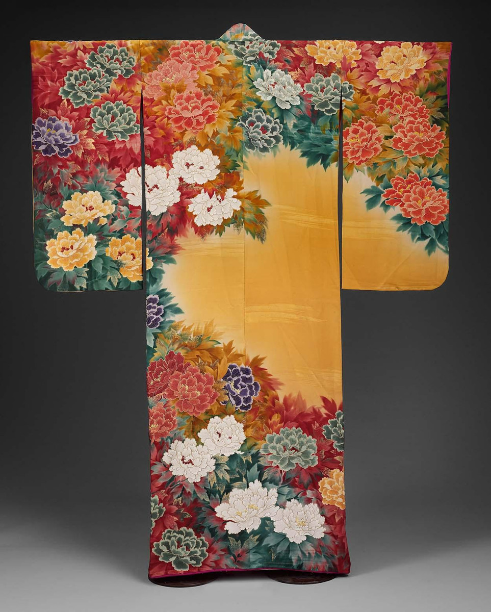 Peonies and peony leaves in white, purple, greens and reds boldly bloom on a shaded mustard ground of this 1930s silk crepe Japanese kimono from the Shôwa era. It was stencil-dyed (kata-yuzen), painted and embroidered with silk and metallic threads, with applied gold paste (kindei-gaki).