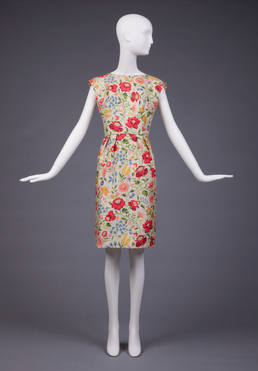 A sleeveless silk dress by Adele Simpson, 1960-1965, is abloom with vivid florals.
