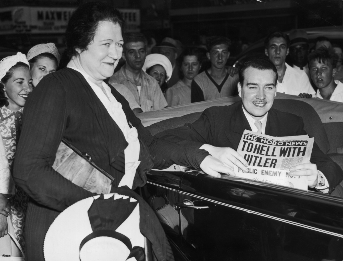 Mrs. Brigid Hitler, the wife of Adolf Hitler's stepbrother, Alois, says goodbye to her son, William Patrick Hitler, outside the Astor Hotel in New York City on June 29, 1941. William, who denounced Hitler, was leaving to join the Canadian Airforce and is holding a copy of a Hobo News issue that also denounced Hitler.