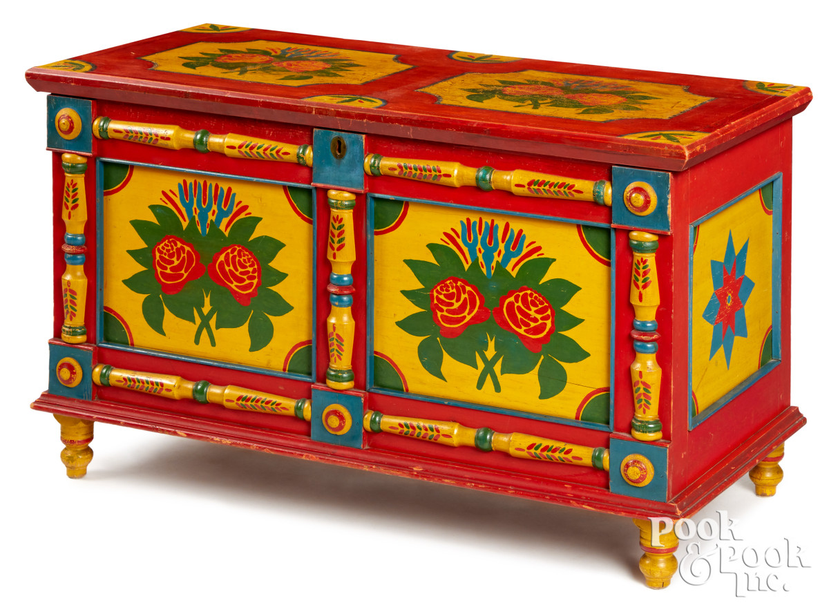An important and vibrant York County, Pennsylvania painted pine blanket chest, ca. 1870, of diminutive size. The decoration is by William Heindel of Jefferson, with applied half-round columns, and remains in a wonderful state of preservation with vibrant floral decoration on yellow panels, with red surround, 23'' x 36''. Estimate: $20,000-$30,000.