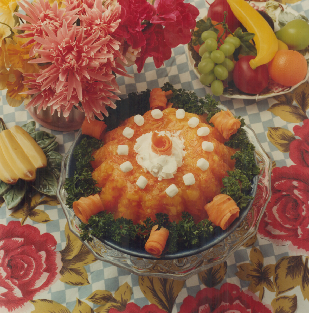 A mold of Sunset Salad from 1962, featuring grated carrots and crushed pineapple floating in orange Jell-O.