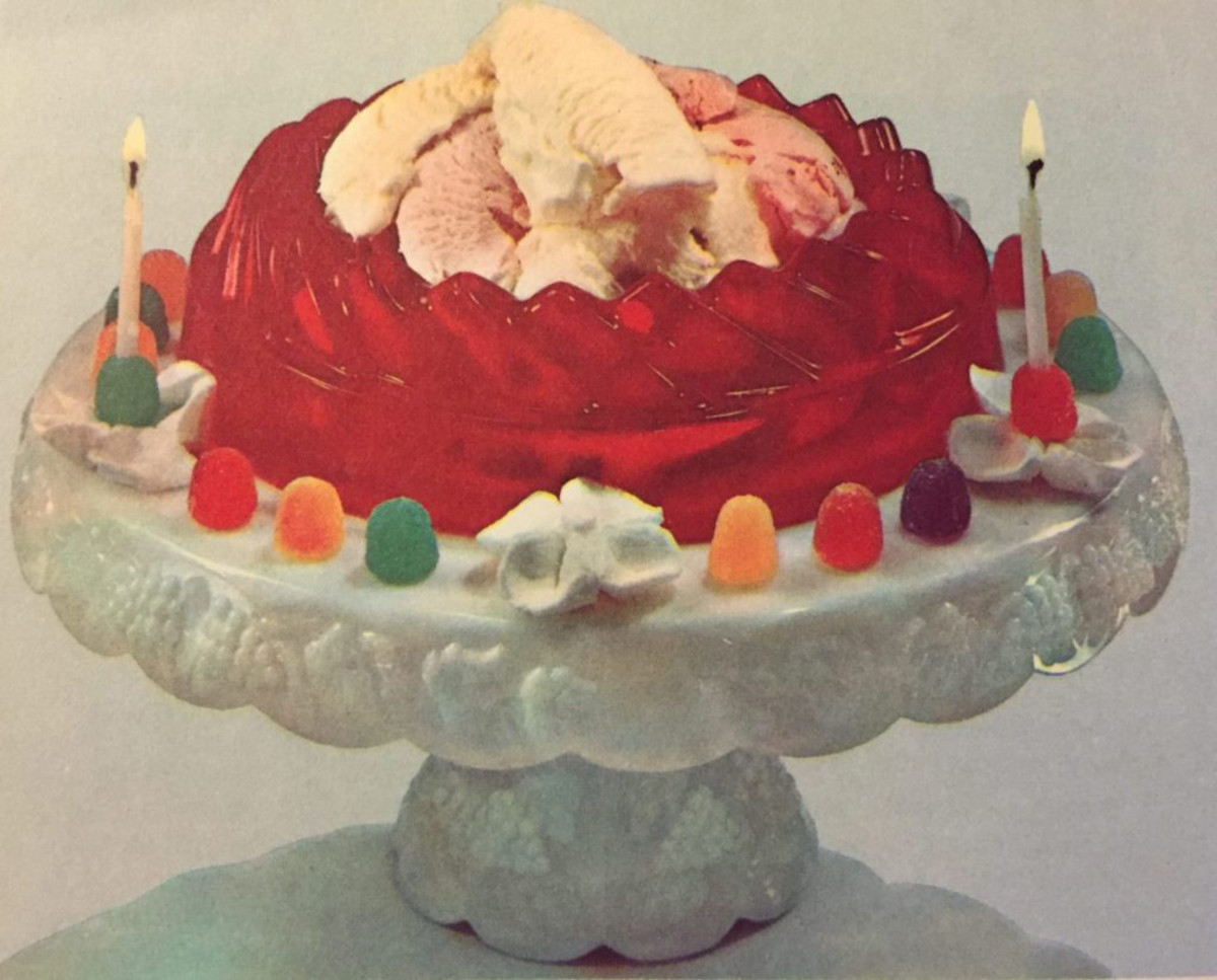 """""""The Joys of Jell-O,"""" 1963, includes this Birthday Surprise, """"a shimmering colorful ring of gelatin filled with ice cream that can replace a birthday cake."""" This probably wouldn't be a nice surprise for someone who wanted a chocolate cake but was served this instead."""