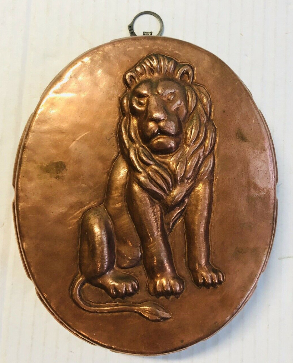 """A mold featuring an animal or figure can be worth more, such as this vintage copper mold with a three-dimensional lion, 8"""", that sold for $124."""
