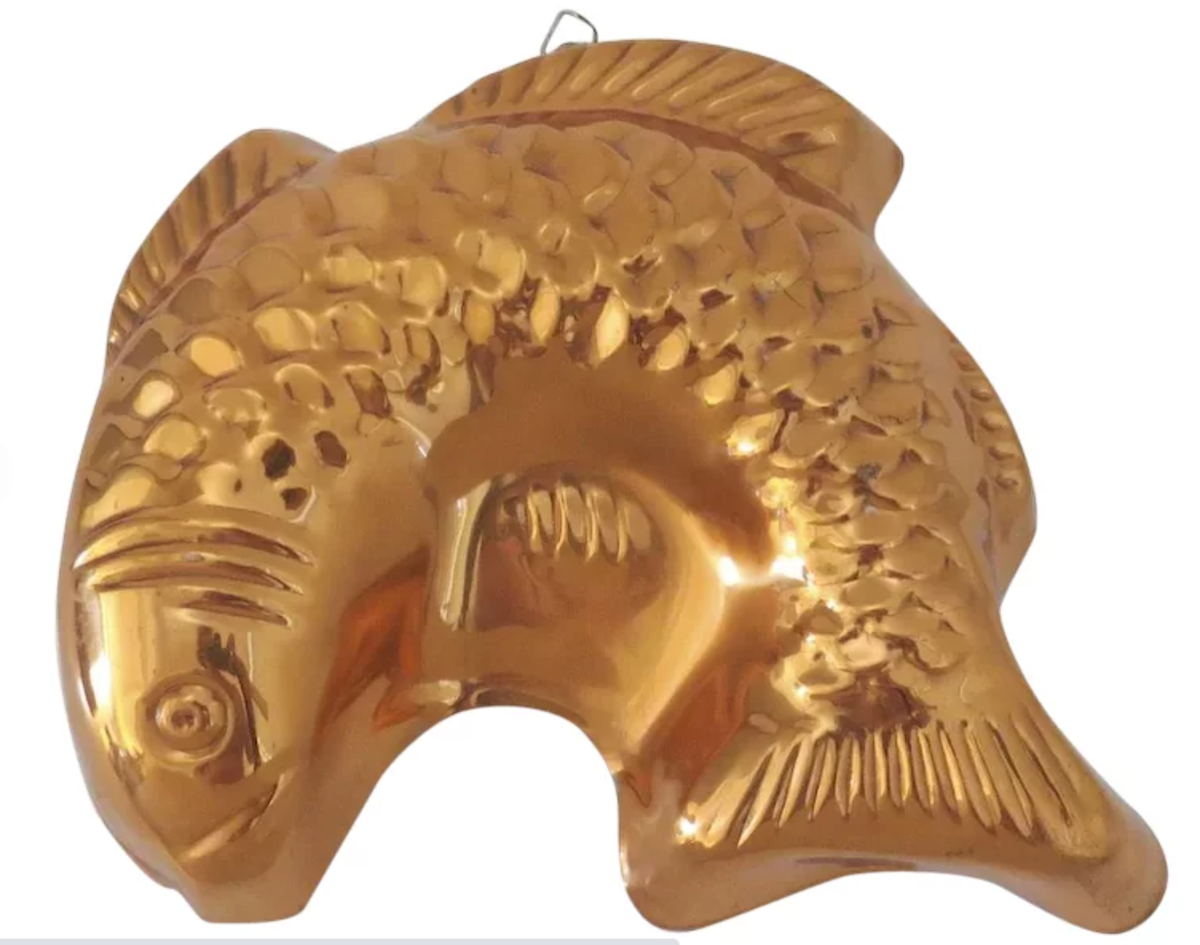 """A vintage copper tin-lined mold in the classic shape of a fish, brass hanging hook, 9-1/2"""" x 8-1/2""""; $16."""