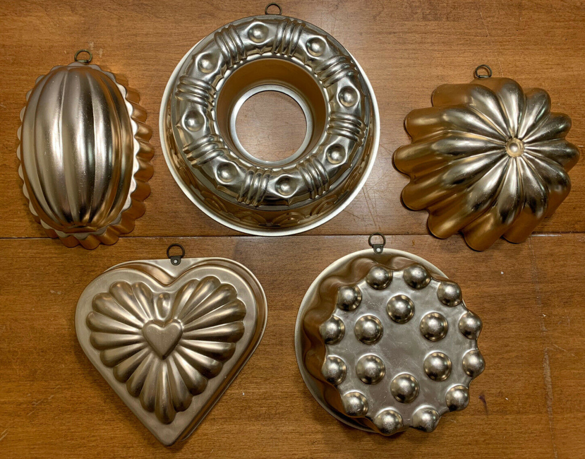 Lot of five vintage copper molds in various shapes and designs; sold for $19.99.