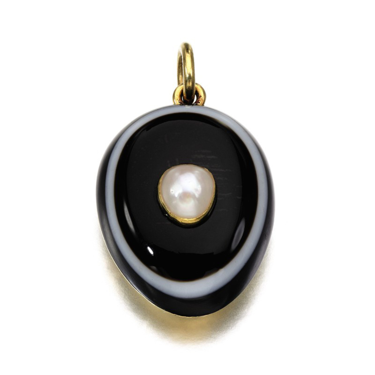 """A banded agate and pearl pendant, 1878, with a glazed compartment containing a lock of hair and the inscription, """"16th Nov & 14th Dec 1878 From Grandmama VR."""" Commissioned by Queen Victoria as a mourning jewel on the death of her granddaughter Princess Marie of Hesse and by Rhine and her daughter Princess Alice of the United Kingdom, who both died of diphtheria that same year. This sold for $33,305."""