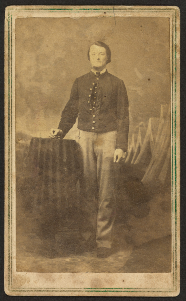 This portrait of an unidentified Civil War soldier taken by J.P. Ball's Photographic Gallery of Cincinnati, Ohio, between 1864 and 1866, has a canceled green 3-cent stamp on the back, as well as Ball's company stamp, shown below.