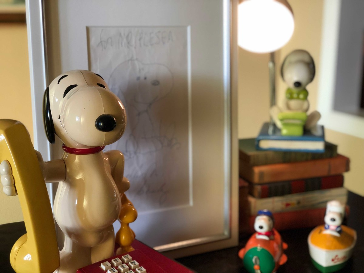 A touch-tone phone is among the prized Snoopy collectibles in Johnson's home.