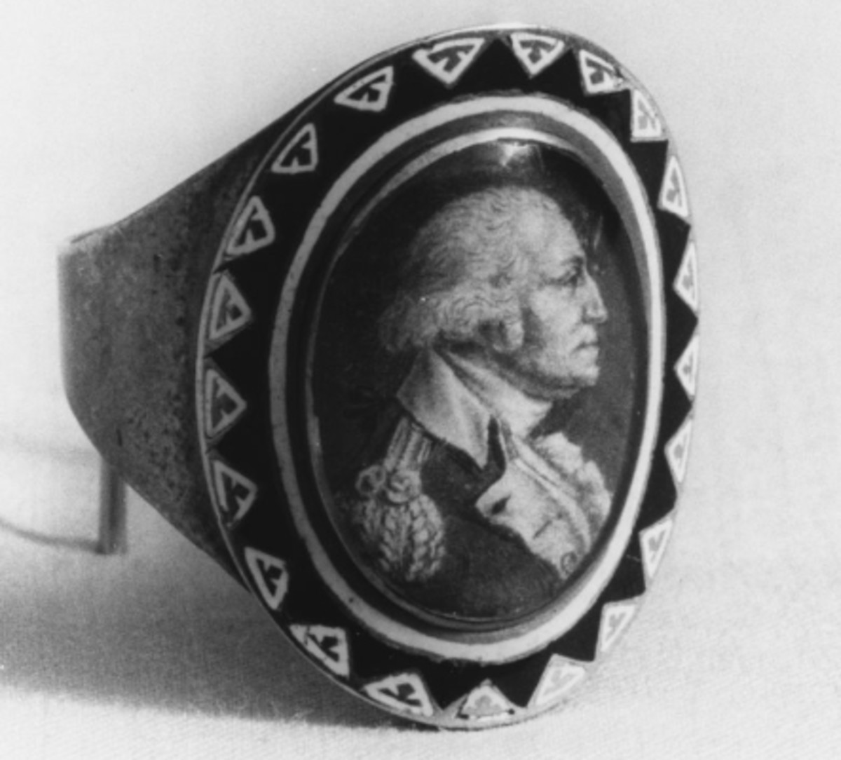 A gold and enamel mourning ring, 1800, featuring a portrait of George Washington.