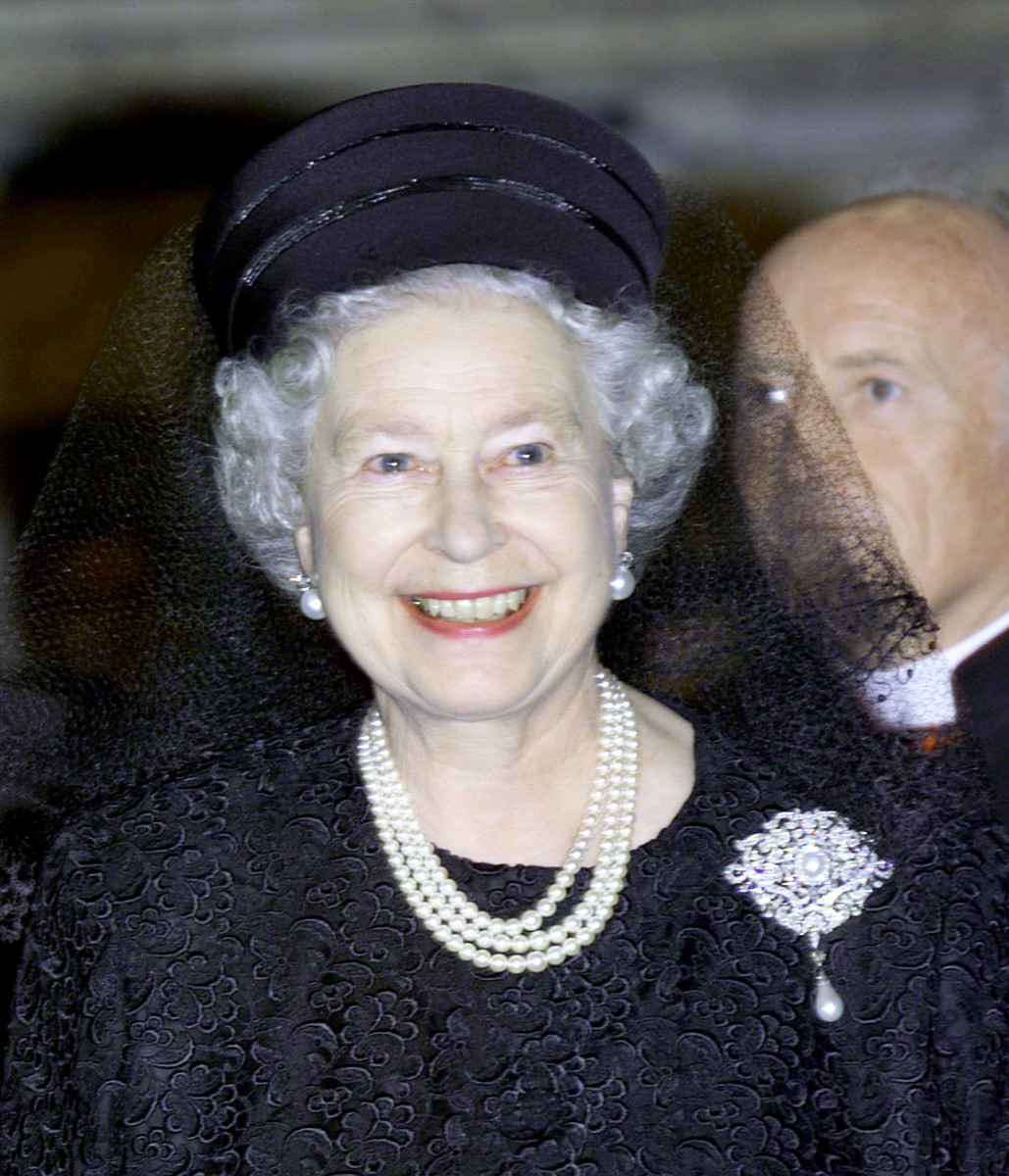 Queen Elizabeth wears the Richmond brooch while visiting the Sistine Chapel in the Vatican City, Rome , Italy, in 2000. For Prince Phillip's funeral, she wore it without the drop pearl.