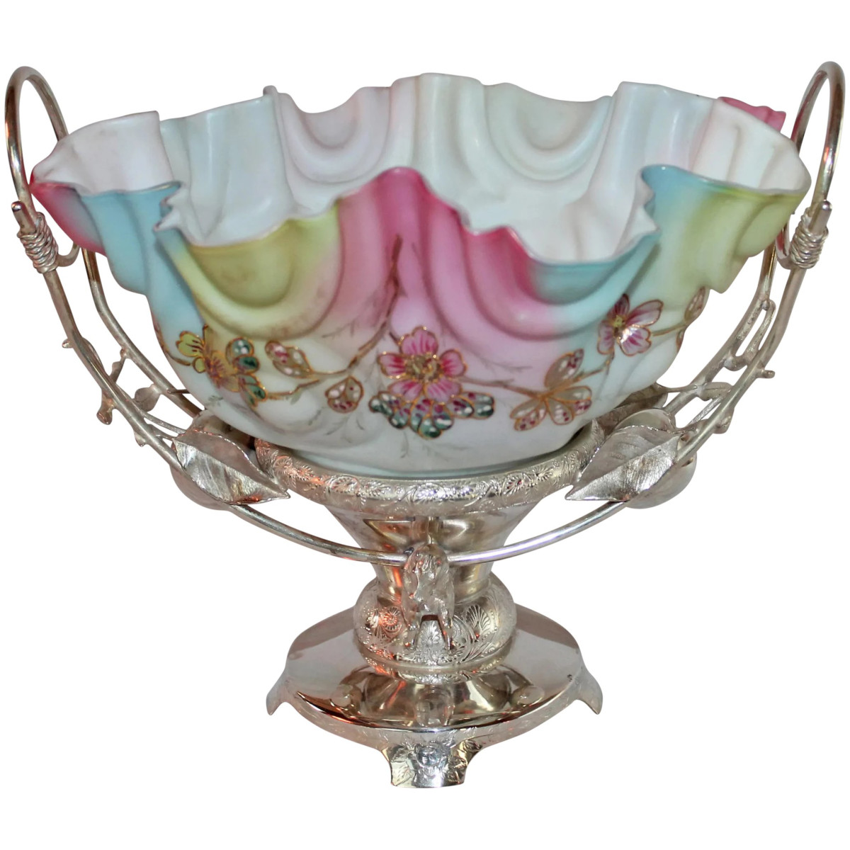 """A rare Victorian horse-and-apple bride's basket made by the Acme Silver Company, circa 1890, with a scalloped rainbow glass hand-enameled bowl, stand features two horse heads (front and back) and apples with leaves on each side of the basket, approx.  10"""" h x 9-1/4"""" w; $4,295."""