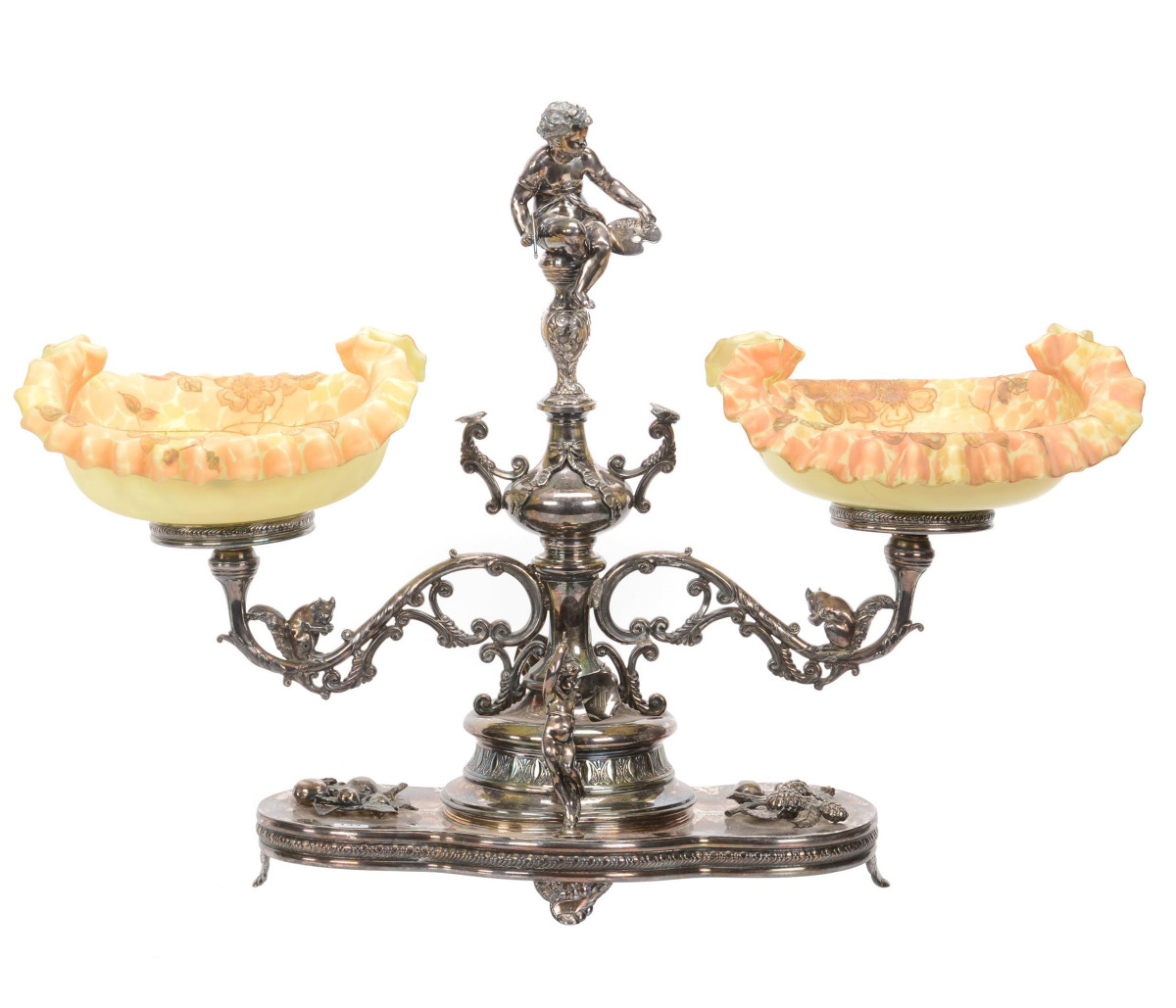 """Double bride's  basket with Crown Milano art glass bowls with enamel floral decoration, mounted on elaborate Pairpoint #2208 silverplate frame that features cherubs, squirrels, fruit branches and butterfly highlights, 20-1/2"""" x 28-1/2"""", total weight of over 16 pounds; $6,500."""