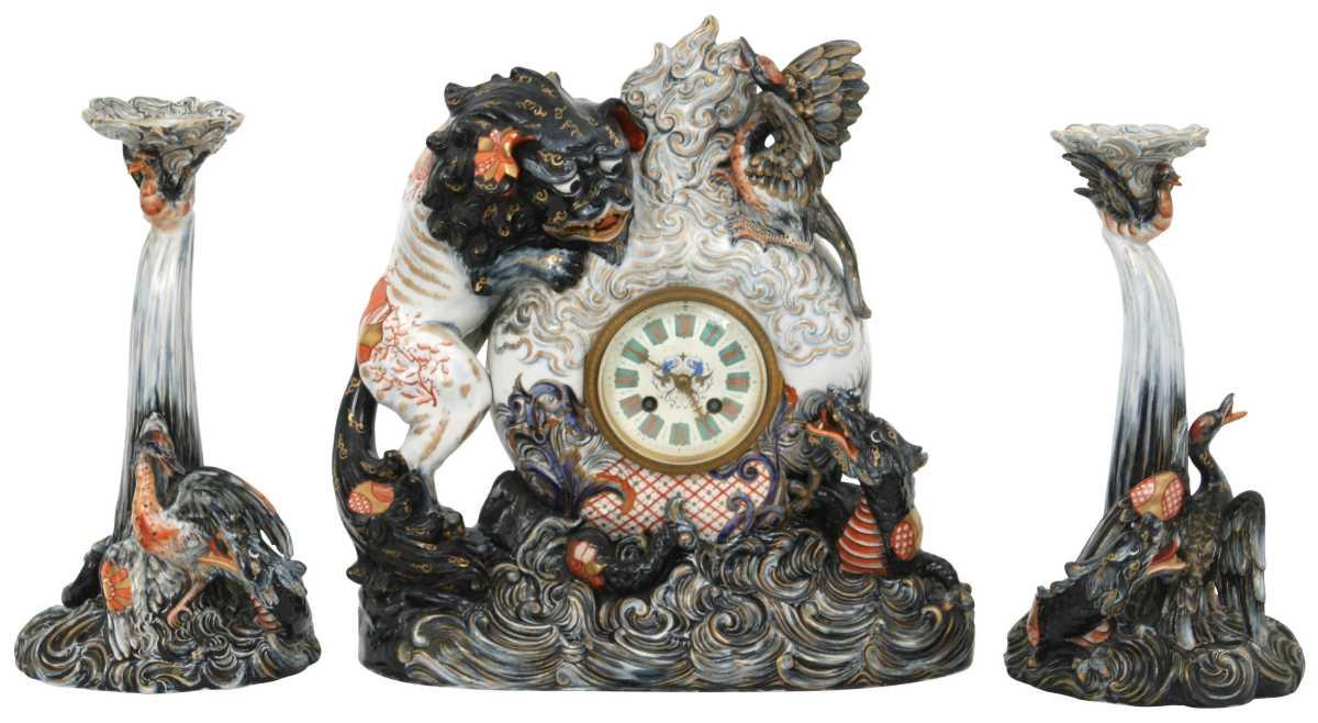 "Émile Gallé pottery clock garniture, late 19th century, 15"" x 13-1/2"" x 7"" (clock), 12-1/4"" x 6-3/4"" (candlesticks); estimate is $5,000-$7,500."
