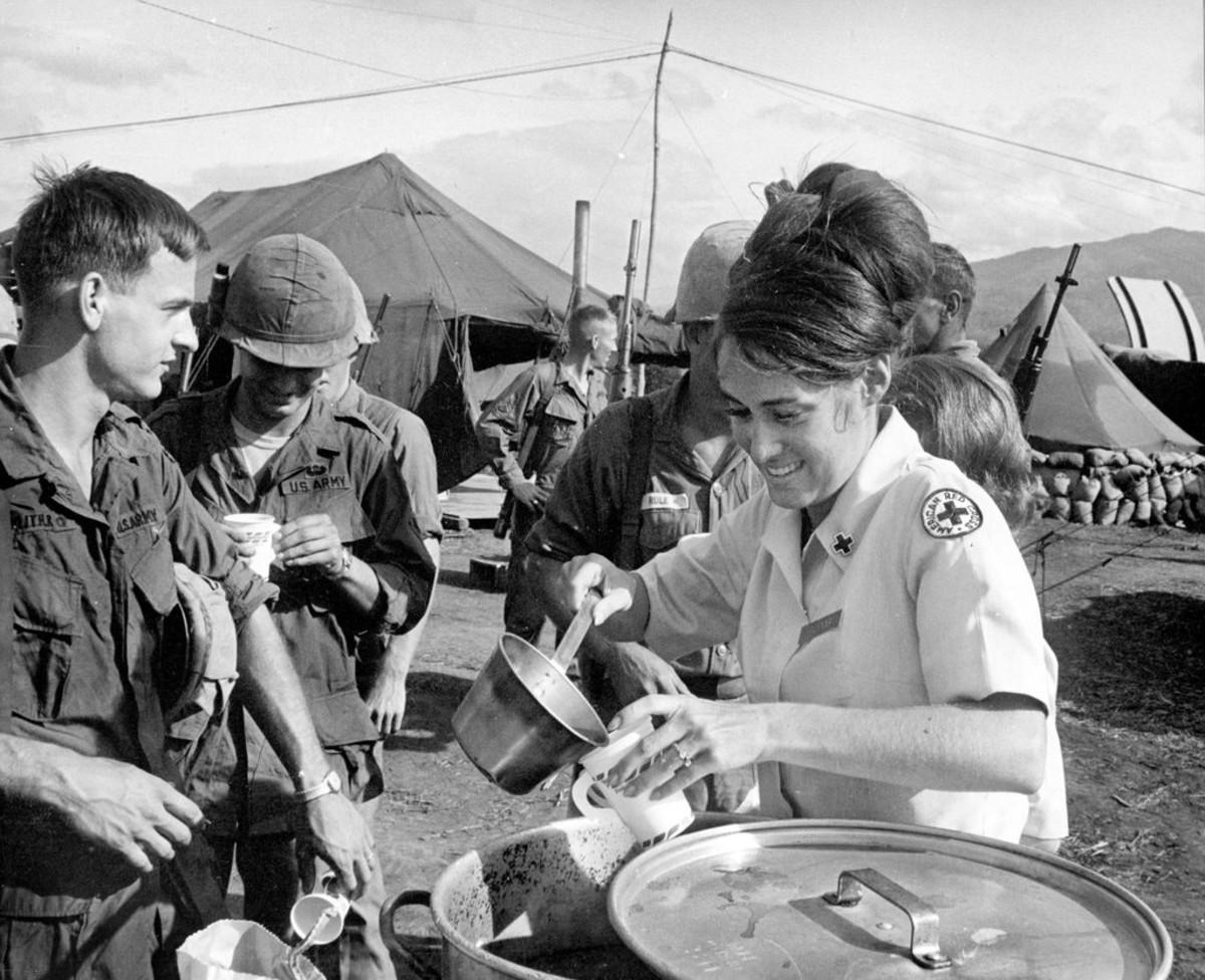 A Red Cross worker with servicemen in Vietnam.