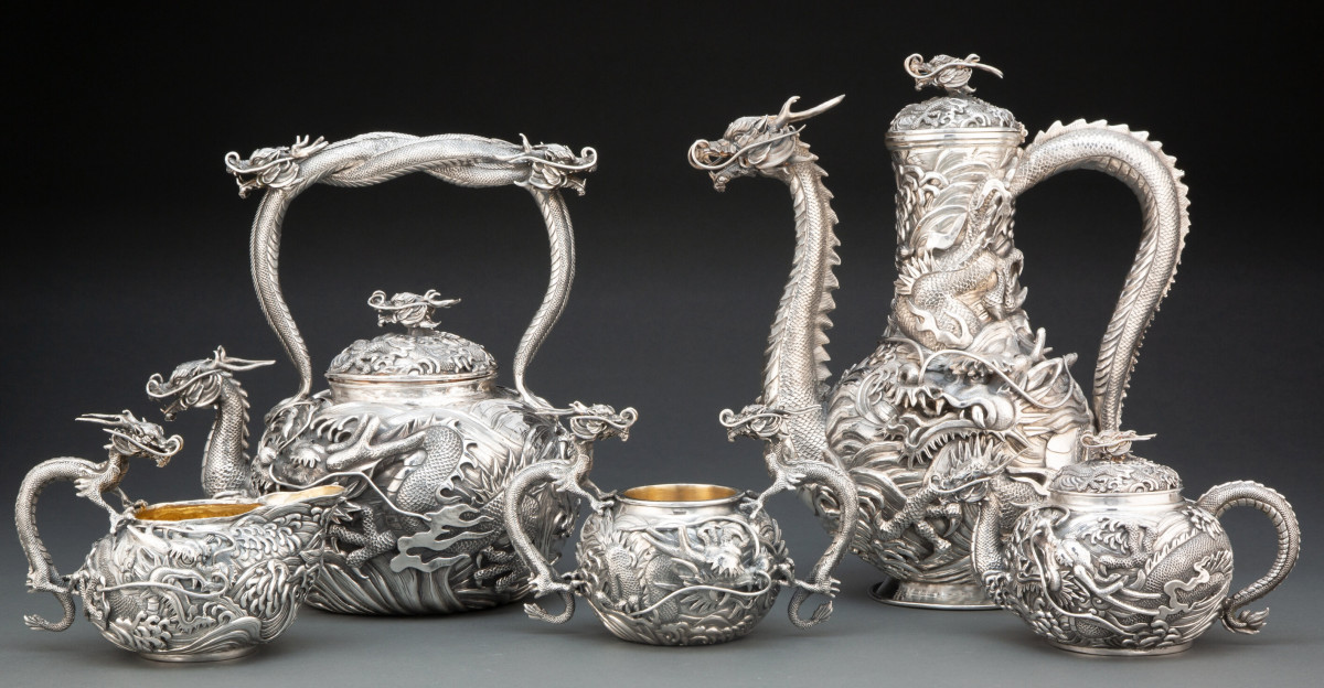 This dramatic, five-piece Japanese dragon-form coffee service, 20th century, sold for $37,500, against an $8,000 estimate. Originally retailed by Kamiwaza, Japan, the service includes a coffee pot, a teapot, a bachelor's teapot, a creamer and a waste bowl.