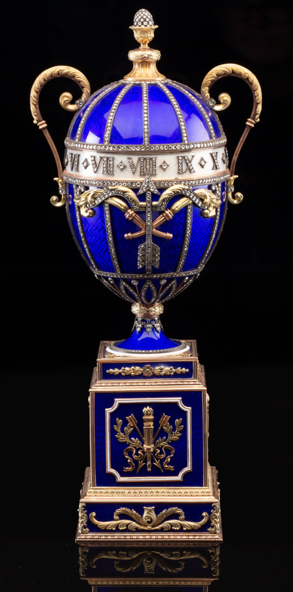 """There is growing collector demand for late 20th-century objects created in the manner of Fabergé, such as this 14k vari-color gold, guilloché enamel, and diamond-mounted revolving egg-form clock with key, 11"""" x 3-1/8"""" x 3-1/8"""" that sold for $42,500."""