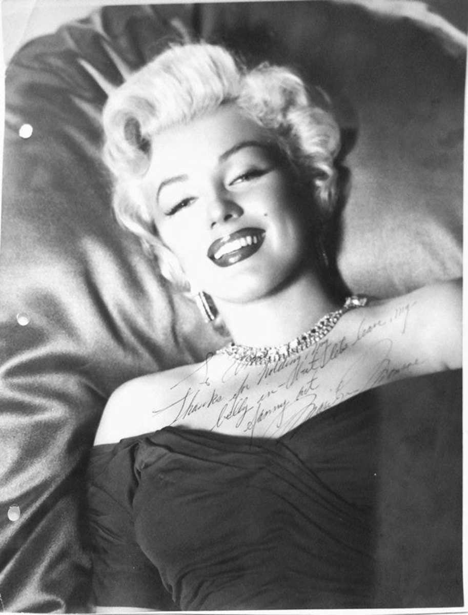 """Authentic Marilyn Monroe autographed photo to a wardrobe stylist named Anne, with the cheeky inscription: """"To Anne -Thanks for holding my belly in - but lets leave my fanny out. -Marilyn Monroe""""; estimate: $3,000-$4,000."""