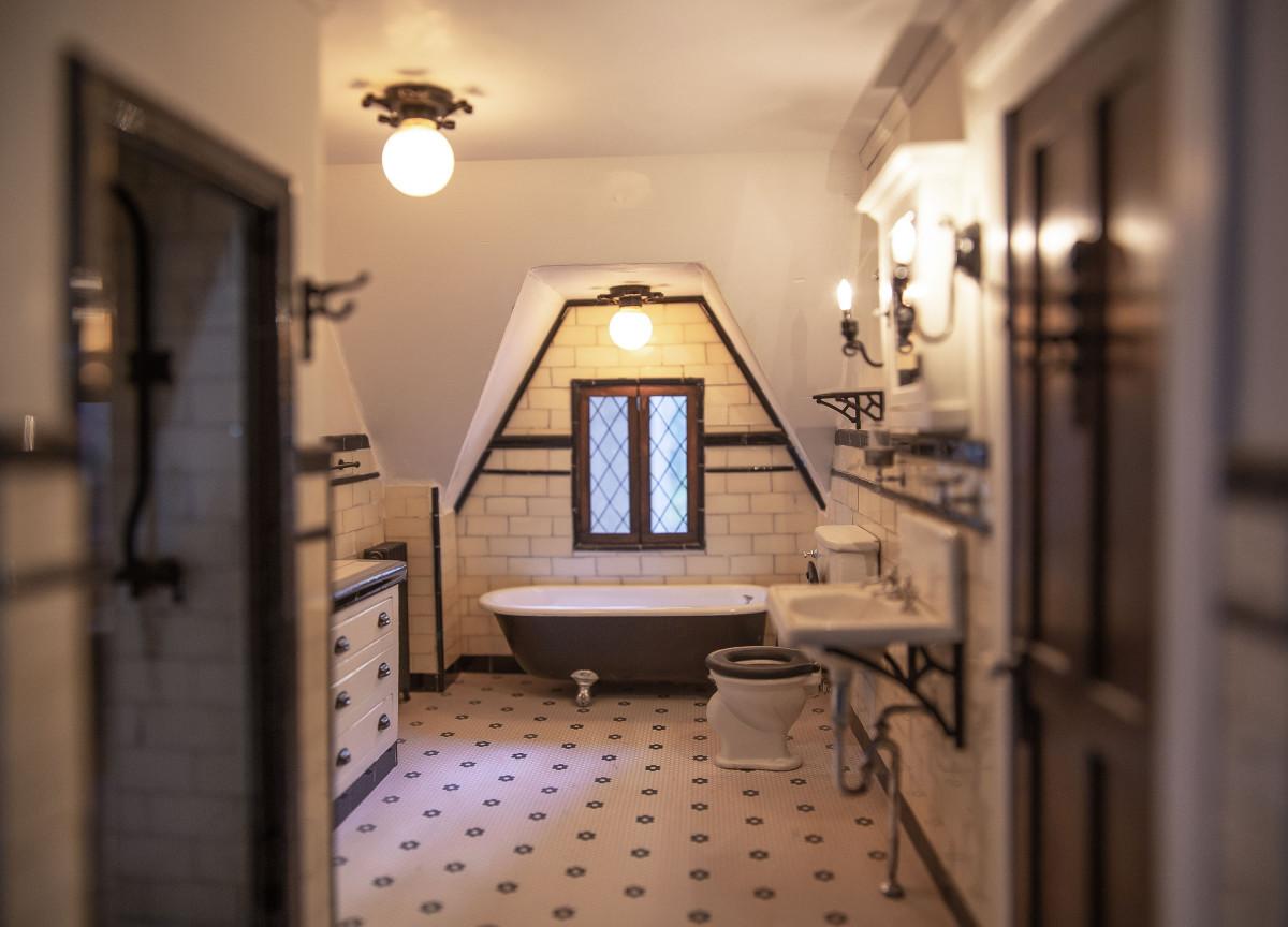 A 1926 Tudor Revival bathroom,  with a claw-foot tub.