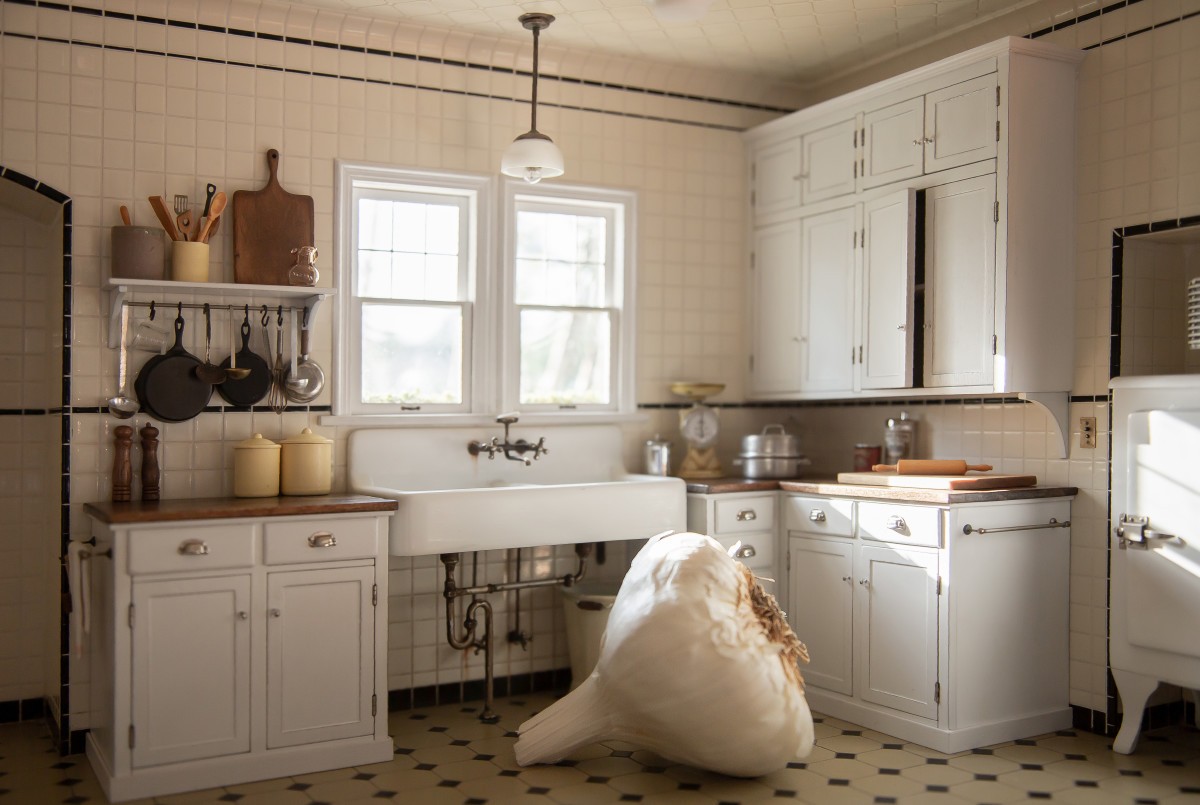 Without the bulb of garlic to show scale, you'd think this 1929 kitchen was the real thing, complete with a recreated antique ice box and scale on the counter.