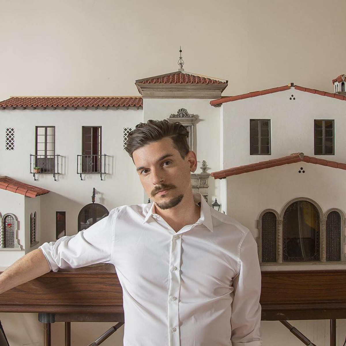 """Artist Chris Toledo with his passion project, """"Casa California,""""  an amalgam of real-life places."""