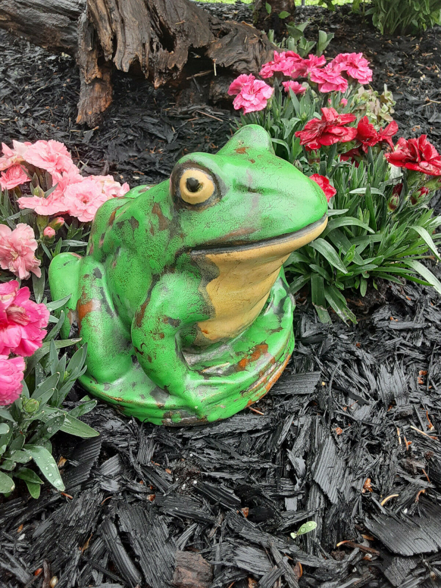 """An early Coppertone  frog that is around one inch larger than the later ones. It is 6"""" h and about  9"""" l, and sits on a 6-1/2"""" base; $395."""
