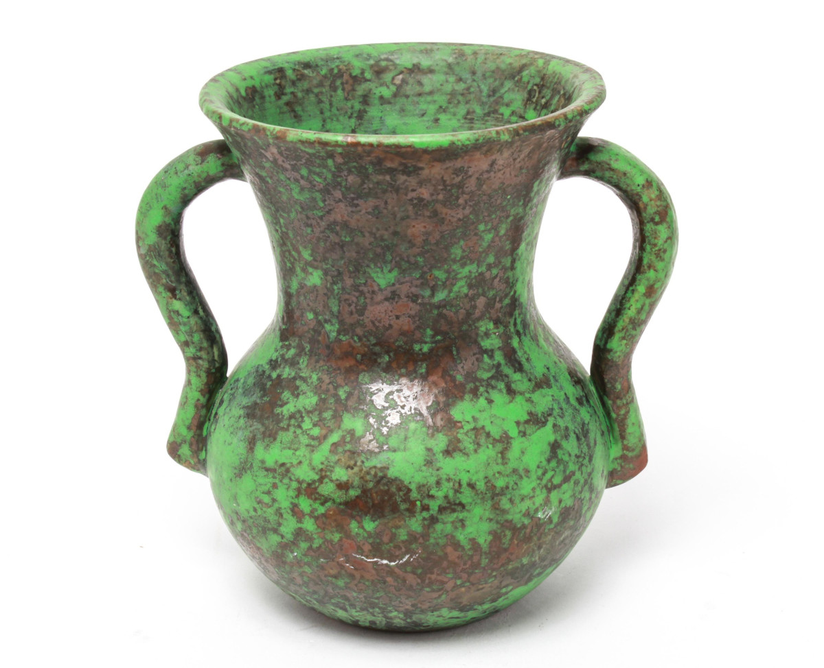 """Not all Coppertone pieces feature summer critters, such as this double-handled vase, inscribed script  marked """"Weller  Hand Made -z,"""" Zanesville, Ohio,  early 20th century, 8-1/2"""" h; $375."""