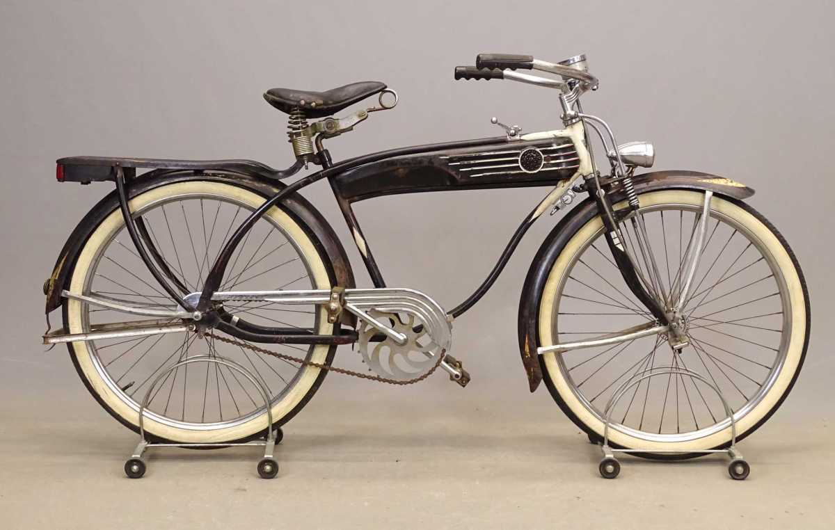 """1939 Montgomery Wards Hawthorne """"Zep"""" men's deluxe with unique twin-bar frame construction, dual Delta Silver Ray headlights, illuminated horn tank and taillight rack, and spring suspension front fork with fork lock. Est: $3,500-$4,000."""