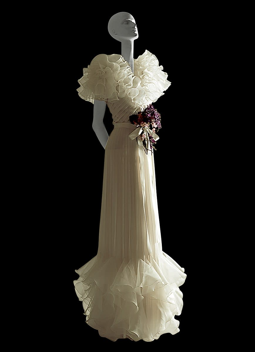 This 1973 white chiffon evening dress with cyclamens by Valentino channels Letty Lynton's '30s nostalgia of romance and femininity that was sweeping the worlds of fashion at the time.