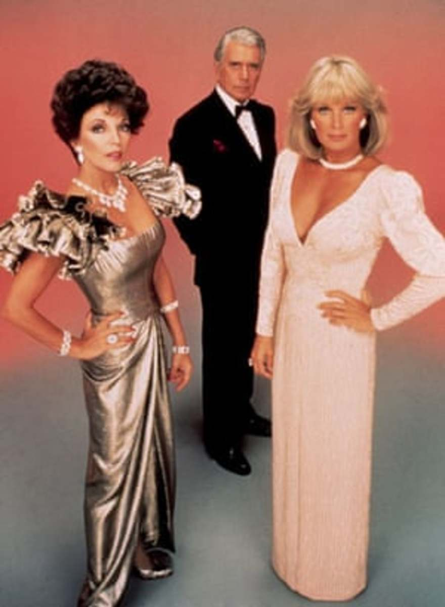 """Although the shoulders of the dress Joan Collins is wearing have a Letty-Lynton vibe, I have no idea if costume designer Nolan Miller was influenced by the dress when he created the fashions for the 1980s' TV series, """"Dynasty."""" What I do know is there's an unwritten fashion rule dictating that you can never mention power shoulders without giving a shout-out to """"Dynasty,"""" so here you go."""