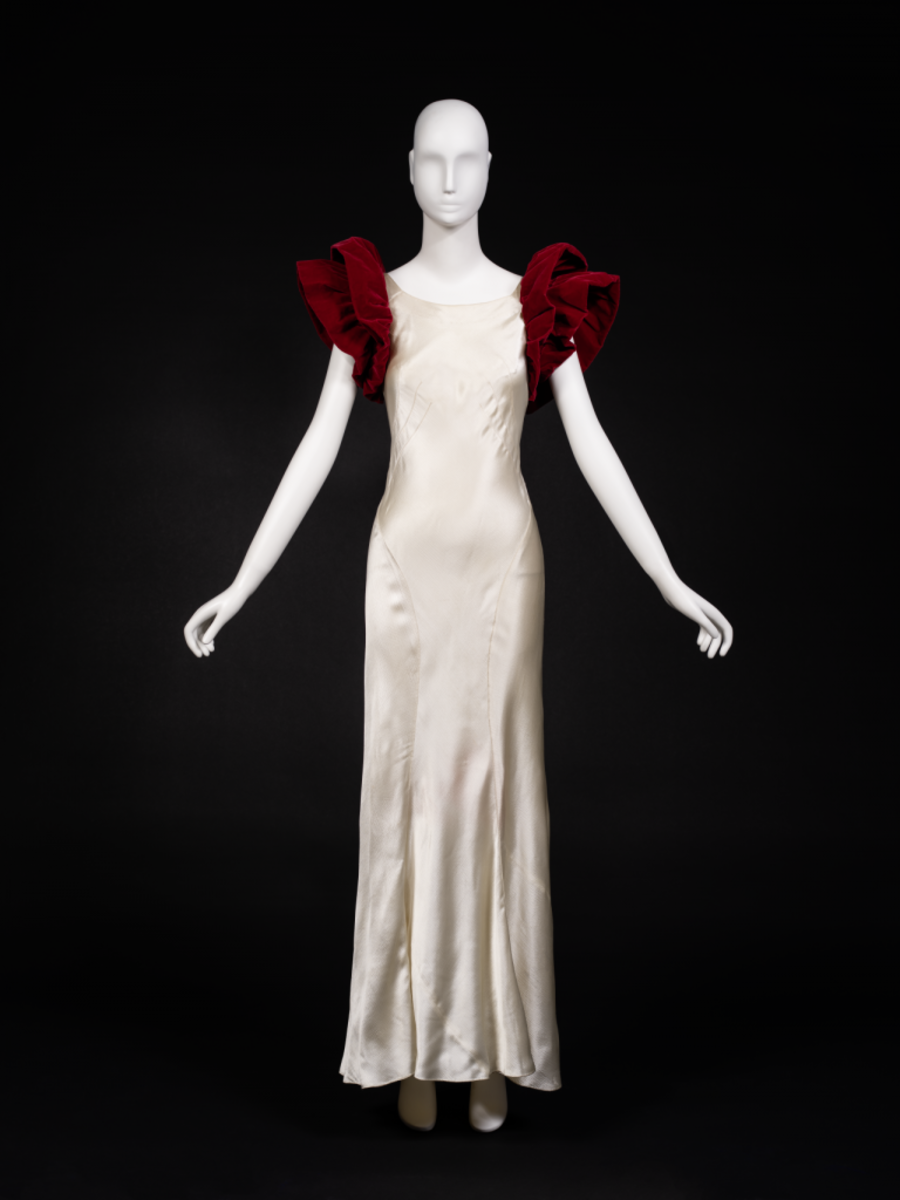 A department store version of the Letty Lynton evening dress, 1933, maker unknown. Since the original dress was too expensive to recreate, most copies just added interesting sleeves.