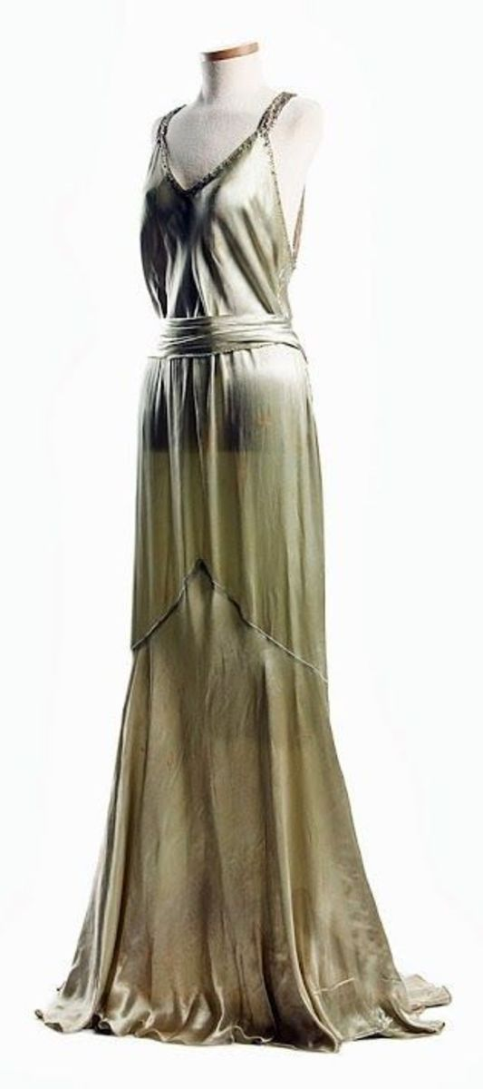 Light green satin dress, c. 1932, worn by Eleanor Middleton Rutledge Hanson for her second court visit at Buckingham Palace in 1932.