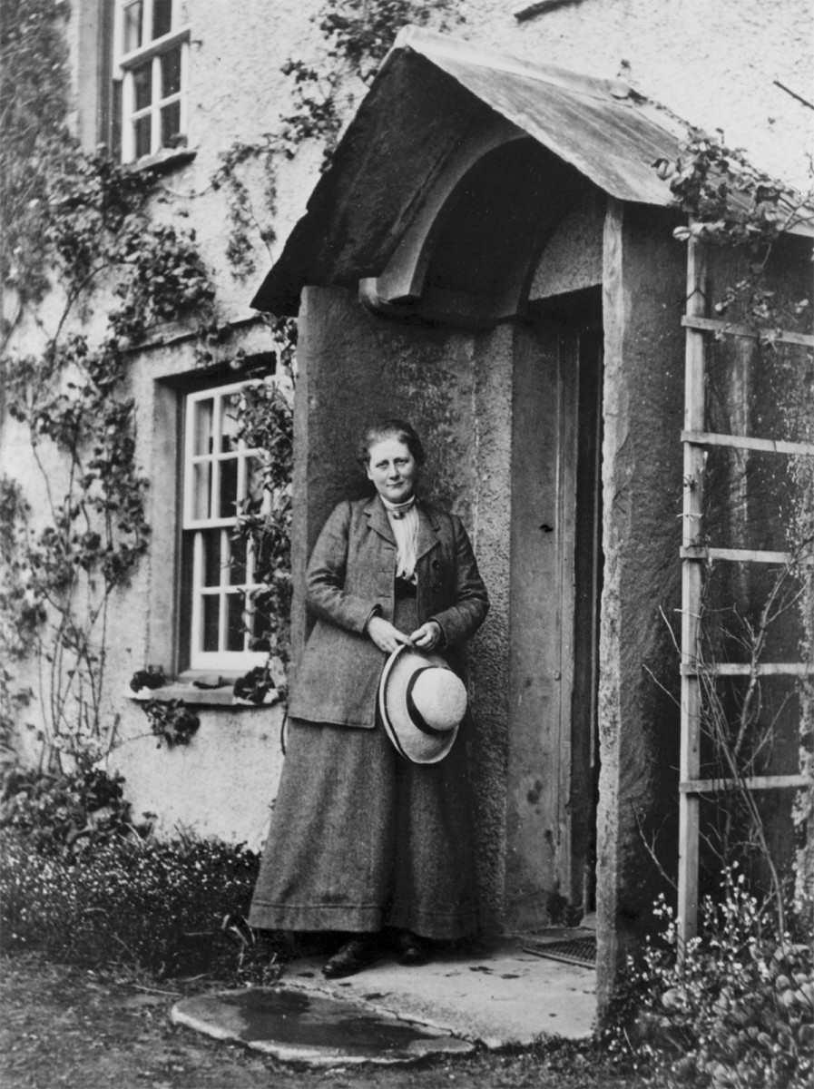 English author Beatrix Potter pictured outside her Kake District cottage near Ambleside, circa 1900s.