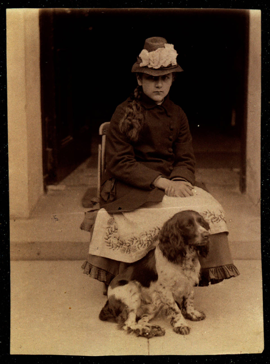 An albumen photograph of Beatrix Potter with her dog, Spot, 1880.