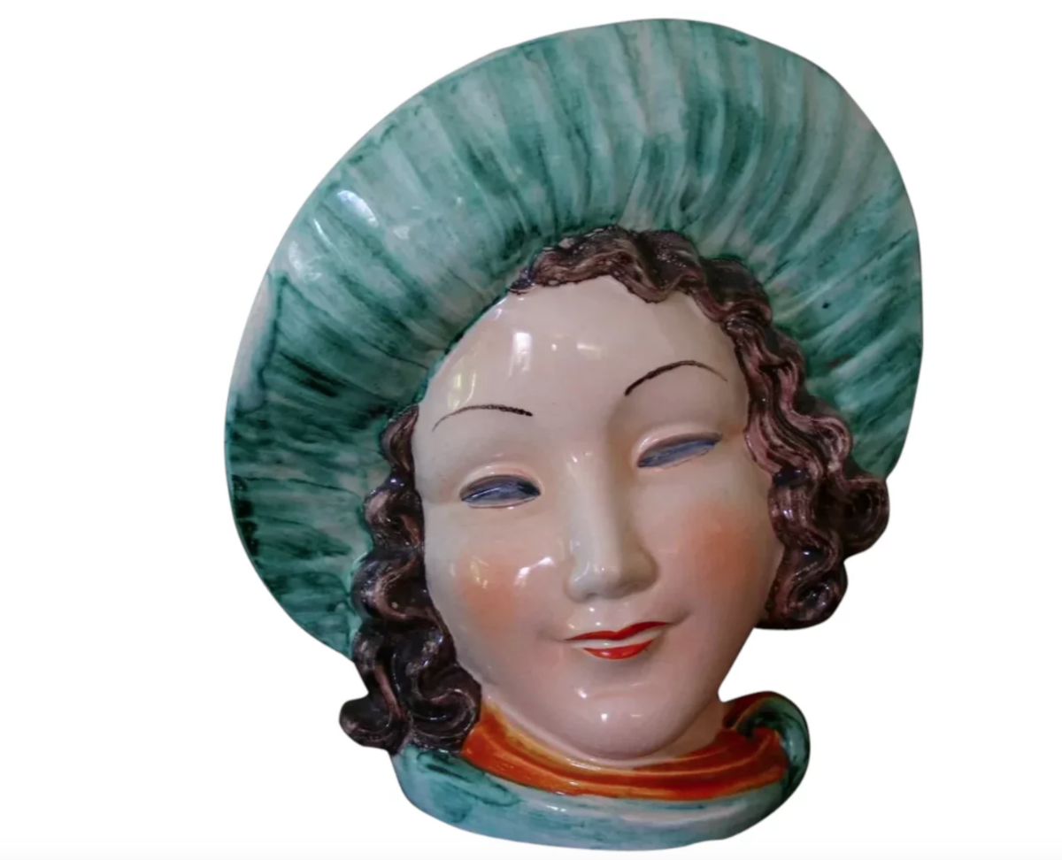 """Rare large-size Art Deco German lady's head vase by Max Roesler, circa 1930s, in the image of a flapper with a wide-brimmed hat, marked with Roesler's green flower backstamp on bottom and number 32, an impressed numeric marking and hallmark and """"Made in Germany,"""" 9"""" h x 7-1/2"""" w; $450."""