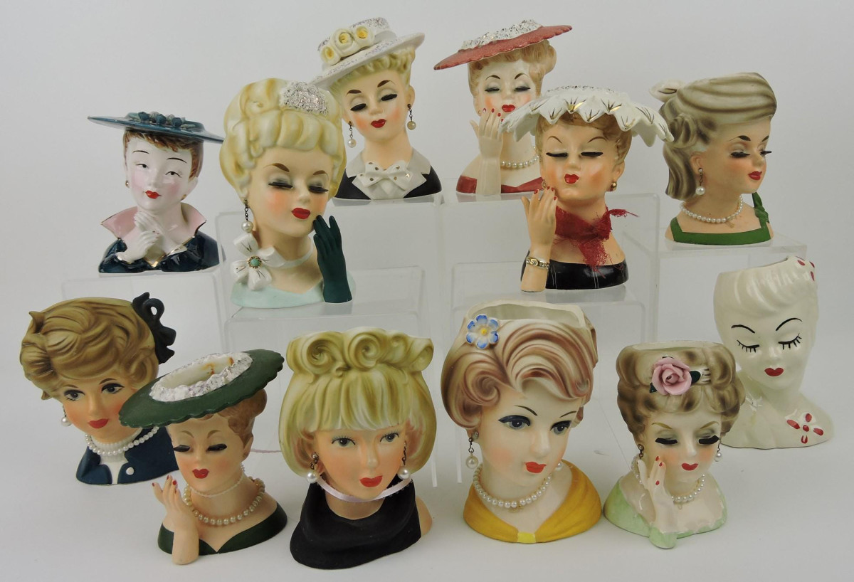 """Lot of 12 Napco and Inarco lady head vases, 4"""" to 6"""" h; $200."""