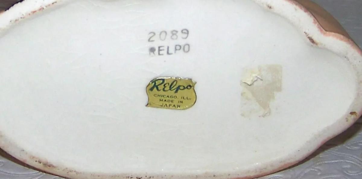 The mark on the bottom of the Marilyn Monroe head vase.