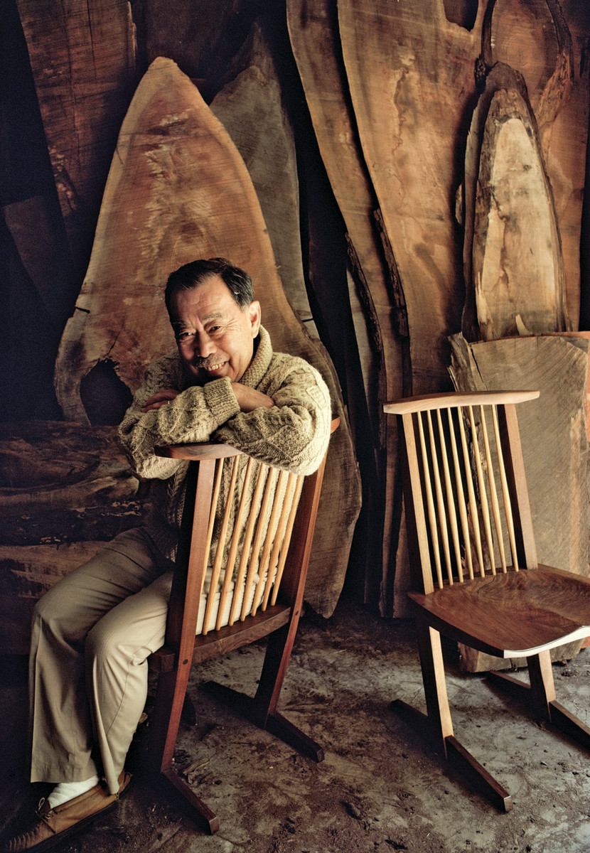 George Nakashima sits in one of his iconic Conoid chairs.