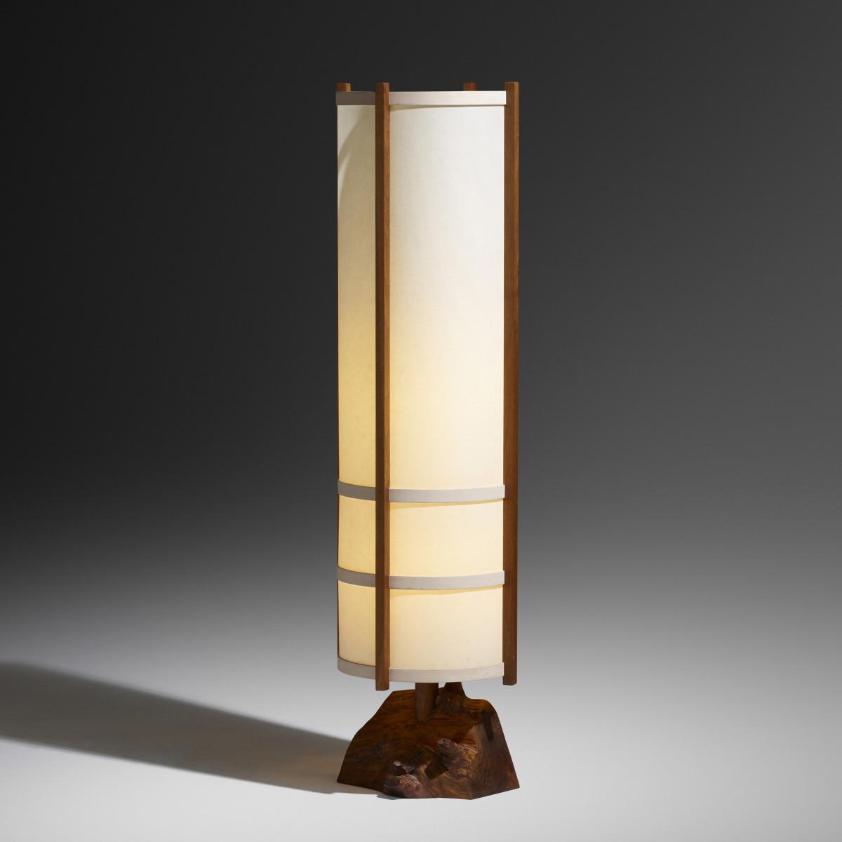 "George Nakashima Kent Hall floor lamp, Nakashima Studio, 1986, walnut burl, walnut, holly, fiberglass, 58-3/4"" h ×  16-1/6"" dia; $62,500."