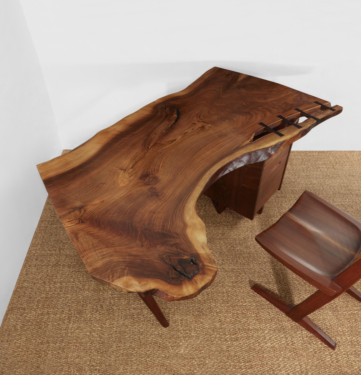 """George Nakashima exceptional  """"Conoid"""" desk, 1961, English  walnut, American black walnut, rosewood and hickory,  29"""" h, 65"""" l, 37"""" d;   $60,000."""
