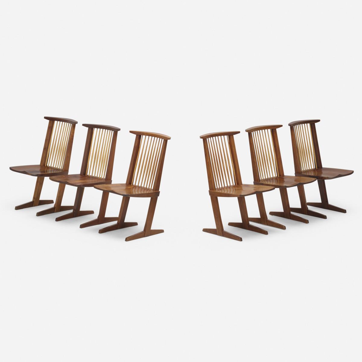 "Set of 6 George Nakashima Conoid chairs, Nakashima Studio, 1988, American black walnut and hickory, 35-3/4"" h × 20"" w × 21"" d; $33,800."