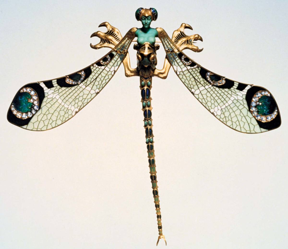 René Lalique Dragonfly Woman corsage ornament, made of gold, enamel, chrysoprase, moonstones, and diamonds, 1897-98.