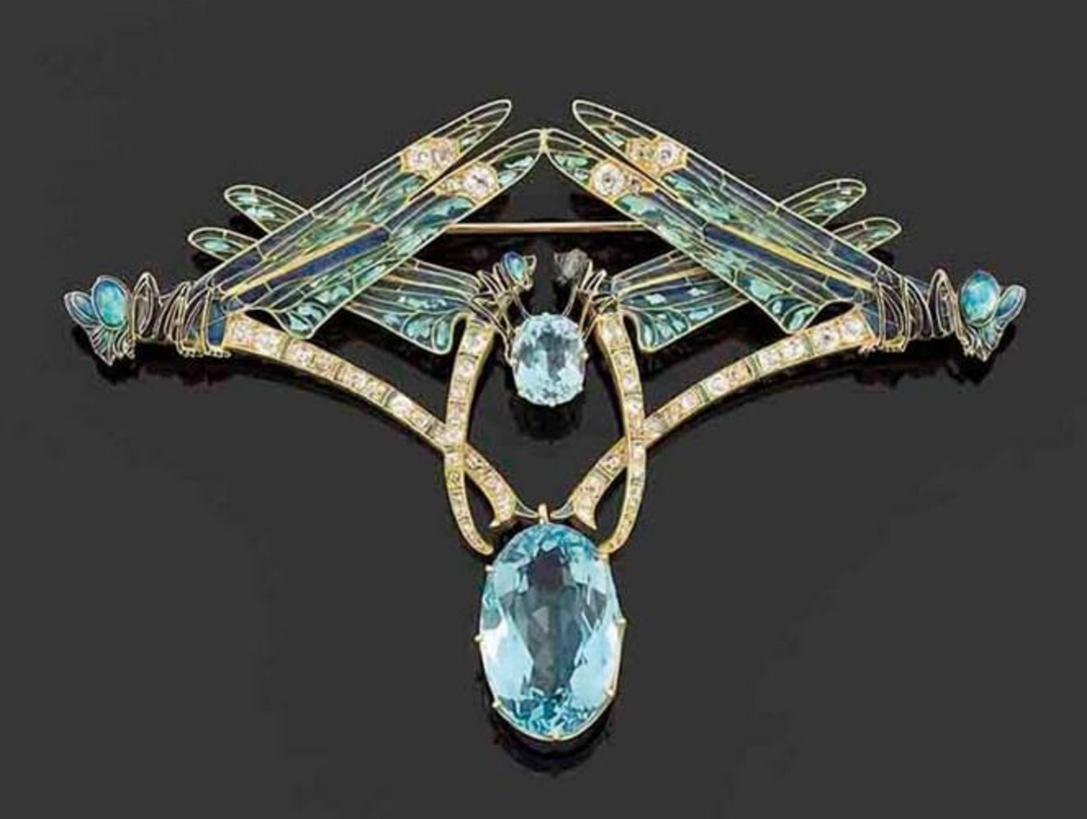 """Lalique """"four dragonflies""""gold and aquamarine brooch with plique-à-jour enamel for the wings, c. 1900; $271,630."""