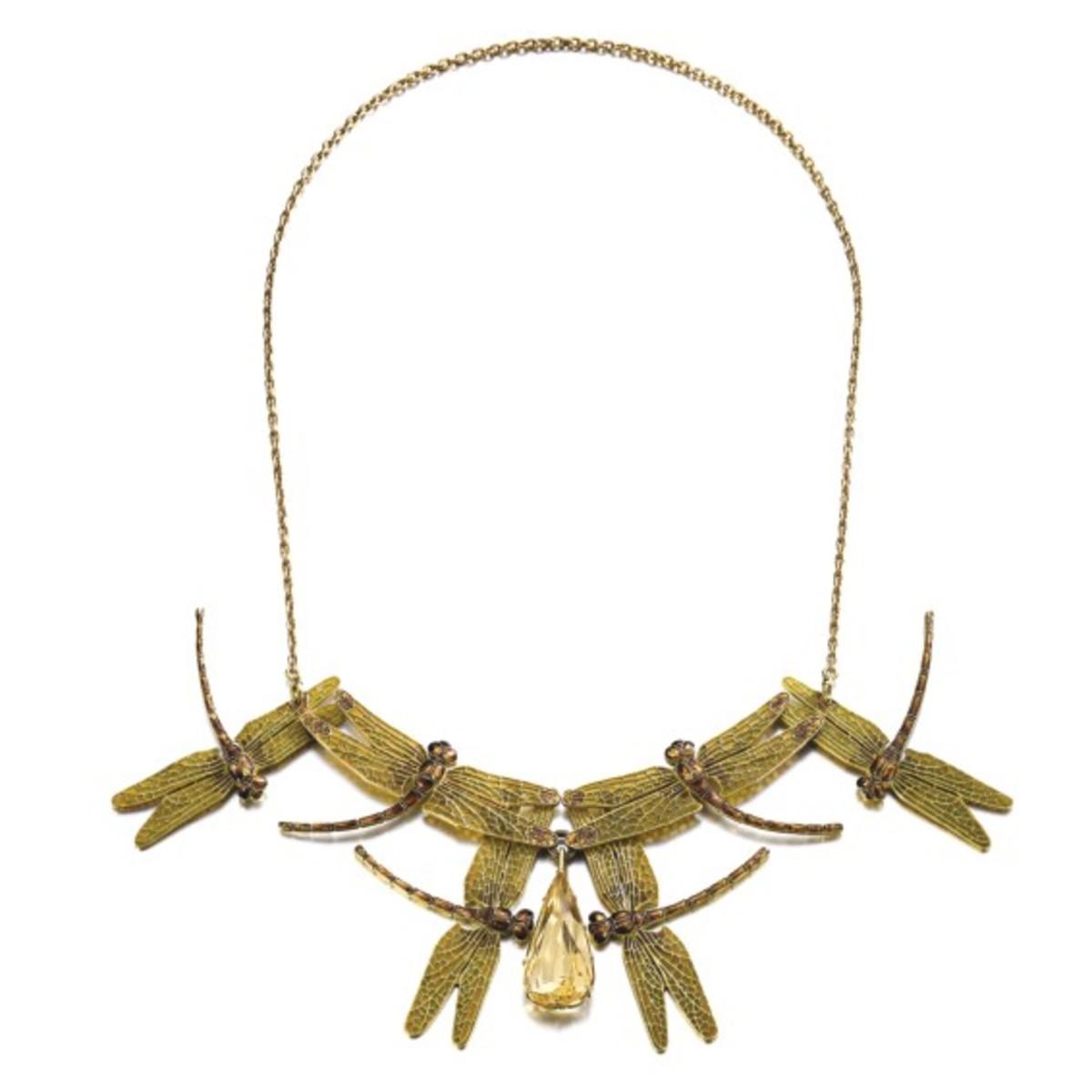 Lalique gold, enamel and citrine necklace/hair comb combination, c. 1900; $262,269.