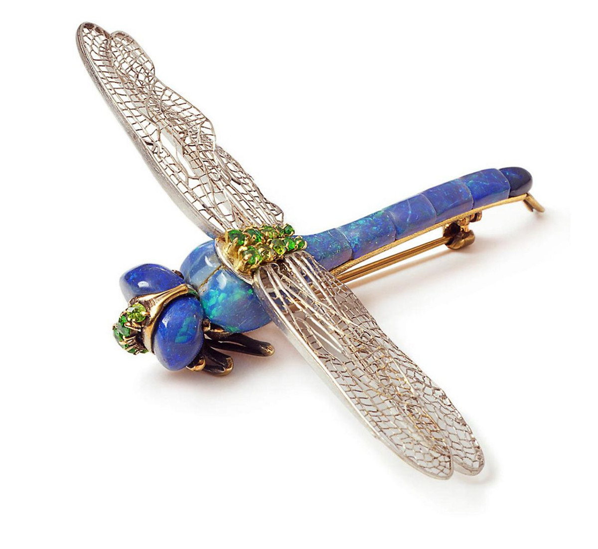 Black opals, demantoid garnets and platinum take flight in this dragonfly brooch by Louis Comfort Tiffany.
